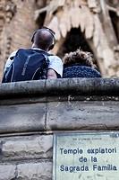 Tourist looking up La Sagrada Familia, Spain