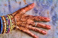Colorful Henna design on womans hands artwork for celebration tatoos in Delhi India