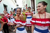 Dancers parade through the streets of Old San Juan during the Festival of San Sebastian in San Juan, Puerto Rico