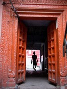 A man passes through a doorway in Haridwar in the state of Uttarakhand in northern India