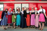 Young women wearing traditional Bavarian costume, returning home from a pre-wedding or ´hens´ party´