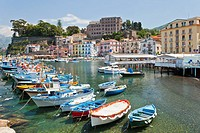 Colorful fishing boats in the bay in Sorrento, Campania, Italy
