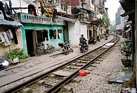 Daily life by the train tracks in Hanoi in Vietnam in Southeast Asia Far East