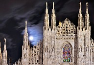 Milan Italy 2011, 10, 12 cathedral windows illuminated for Christmas celebrations, shot at night under cloudy moon