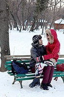 Couple spending a day in a snowy park in Bucharest, Romania