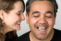 Close-up of mature couple laughing  Wrinkles and stubble are visible
