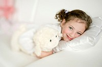 Czech Republic, Portrait of cute girl (4-5) with cuddly toy