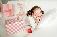 Czech Republic, Portrait of cute girl (4-5) with presents