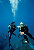 Diving  decompression: helping fellow diver. Mauritius Island, Republic of Mauritius, Southwestern Indian Ocean