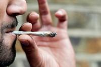 Man smoking cannabis-close-up