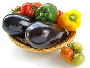 Basket with aubergines, tomatoes and peppers,