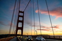 Crossing the Golden Gate Bridge at sunset, San Francisco, California, USA