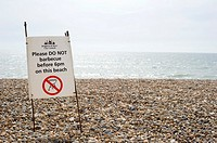Sign reads: Please DO NOT barbecue before 6pm on this beach  Brighton & Hove, East Sussex