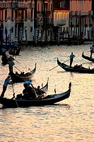 Gondolas carrying tourists on Grand Canal in Venice