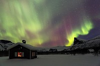 Northernlight in Sarek national park in swedish lapland with a cottage in winter time