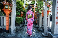 Tourist dressed with kimono on the streets of Kyoto, Japan, Asia