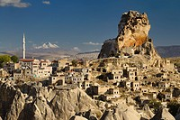 View of Ortasihar rock Castle with minaret Mount Erciyes and fairy chimneys Cappadocia Turkey