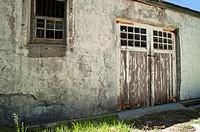 Peeling paint on barn doors of an old building
