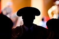 Silhouette of a bullfighter´s head wearing the traditional hat or ´montera´, spain