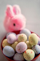 Pink bunny with colorful easter eggs