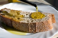 Traditional bread washed down with olive oil