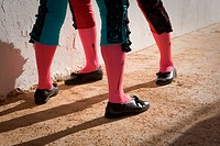 Legs of bullfighters waiting in the patio de cuadrillas, Jaen, Spain
