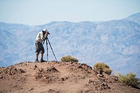 A photographer looks at the landscape from Dante's View in Death Valley National Park, California, USa