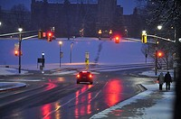 A car stops at a red light on a snowy morning in Ontario, Canada. Fresh snow covers the hill, but salt has been spread to melt the snow on the road, a...