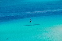 blue sea with windsurfer at Spiaggia, Sardinia
