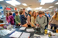 At the direction of their teacher (left background) high school chemistry students place their cell phones on her desk before class in San Clemente, C...