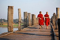 Two young monks crossing U Bein bridge. Myanmar, Mandalay, Amarapura, U Bein.