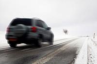 Fast car on snowy winter road.
