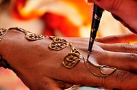 On the day of marriage in the morning, bride having henna painting.