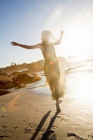 Young Woman Celebrating On Beach.