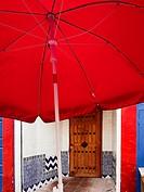 Red umbrella on the front door.