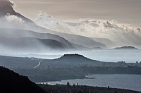 Looking south down the Messinian coast of the outer Mani on a misty morning with. The seaside town of Stoupa and the prominent mound of its ancient ac...