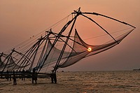 Chinese fish nets at sunset in Fort Cochin (Kochi) in Kerala, India.