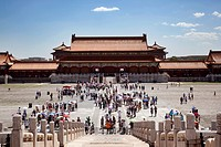 Beijing, China-August 5, 2010: Despite the strong heat in Beijing in August, thousands of tourists visit the Forbidden City each day, shielding the su...