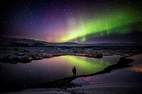 Taking pictures of the Aurora Borealis or Northern lights at the Jokulsarlon, Breidamerkurjokull, Vatnajokull Ice Cap, Iceland.