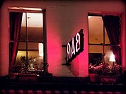 Bar pink sign and windows at night, near Waterloo, Lambeth, London, UK
