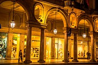 Arcaded shopping area in Turin at night.