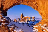 Morning light on North Window framing Turret Arch in winter, Arches National Park, Utah USA.