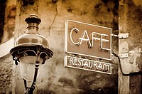 Cafe sign and lamp post, Paris, France.