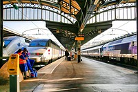 SNCF Paris Railroad High Speed Trains at the Paris Est Station (Gare), One Passenger Boarding the Train, Two Workers Waiting.