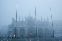 St. Mark's Basilica and Square covered with thick fog. Venice, Italy.