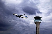 Air Traffic Control Tower with a Plane Taking Off. Luton Airport, UK.