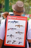 vendor with gun offer on the street, Honolulu, Hawai'i.