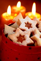 Close up of Christmas cookies and candles.
