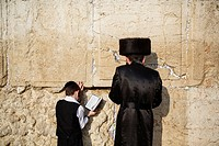 Jewish people praying at the wailing wall known also as the western wall , Jerusalem, Israel.