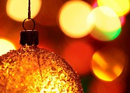 Close-up of Christmas ornament and defocused Christmas lights.